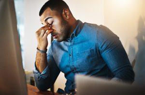 Tired Man Behind Desk