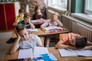Children Tired or Asleep at Desks