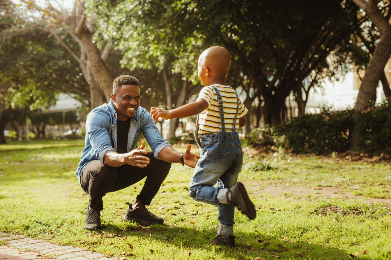 child running into his father's arms