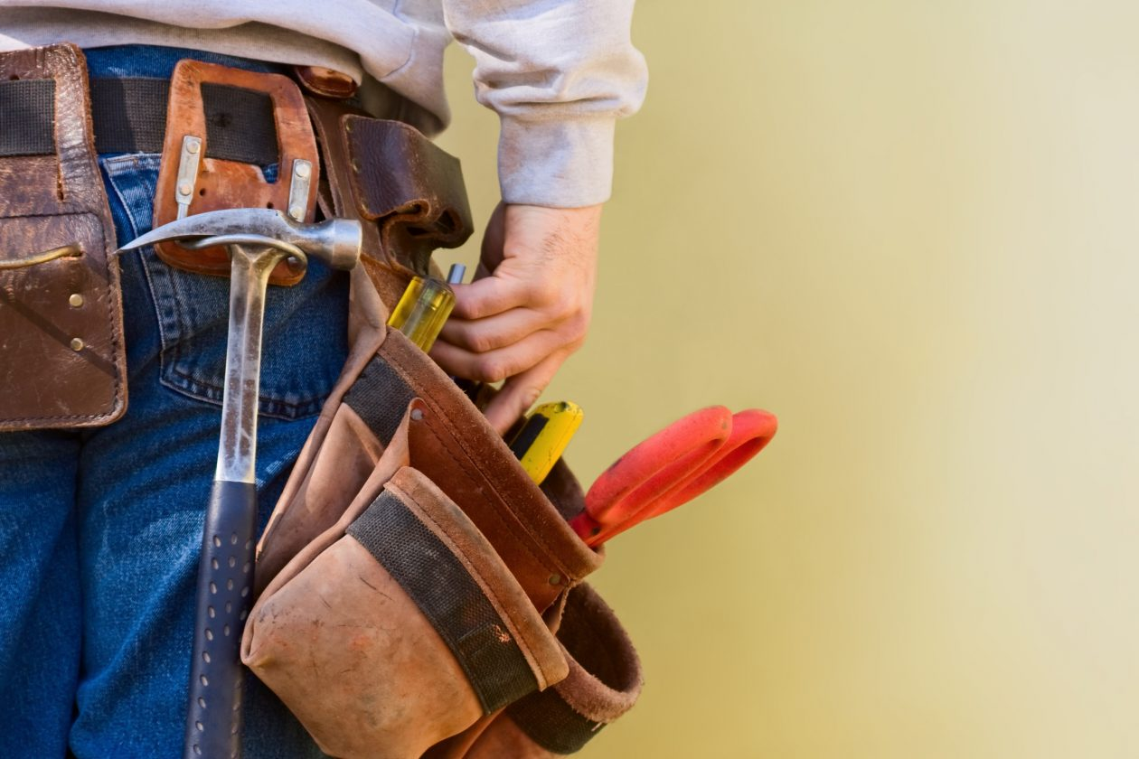 Handy Man Wearing A Tool Belt