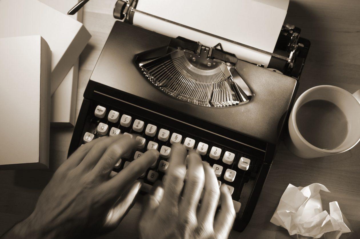 man using typewriter